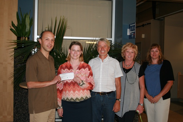 Jason from Polaris Travel Clinic and Pharmacy presents a cheque to the Airdrie Health Foundation.  From left to right:  Jason Kmet, Michelle Bates, Dr. Julian Kyne, Sherry Monsour, Brandy Horn